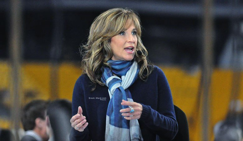 Suzy Kobler captured while speaking, she has used a hands gesture.