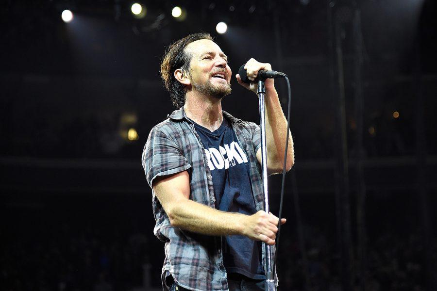 Eddie performing at a concert