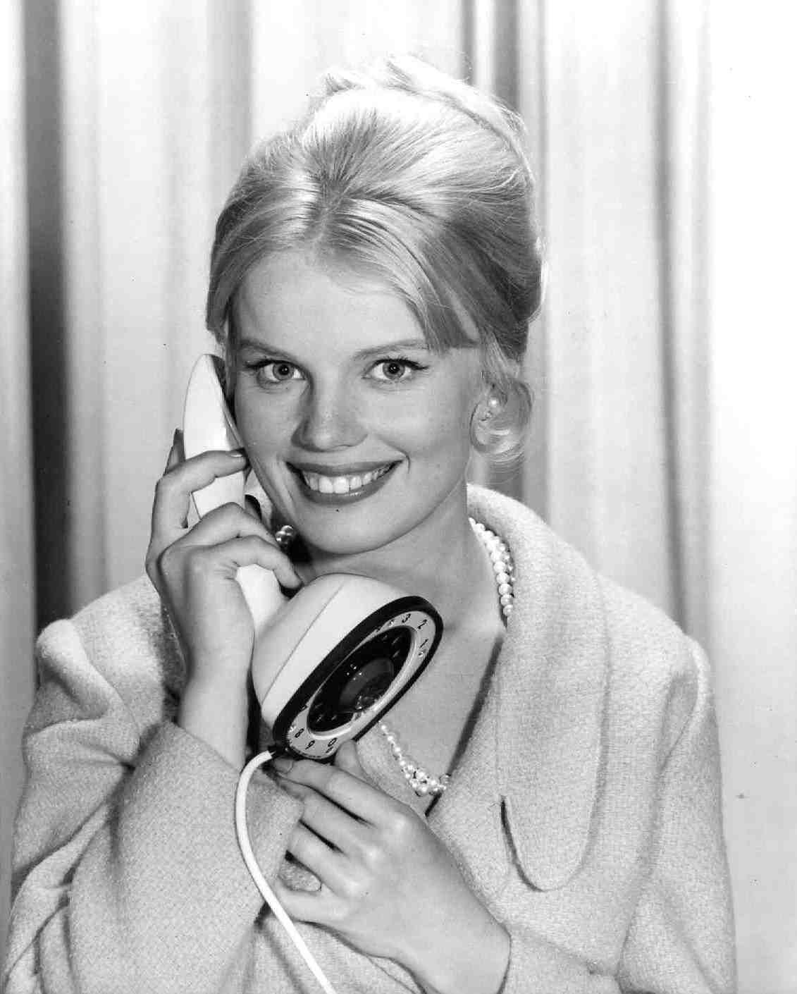 Marta Kristen talking on telephone