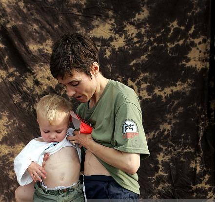 Catherine Herridge holding her cancer survivor son
