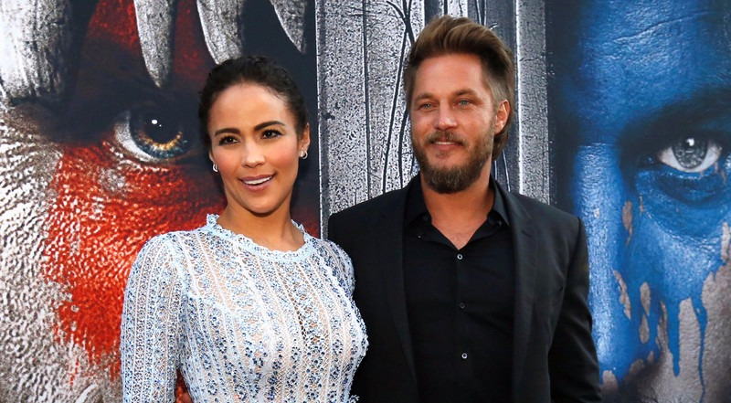 Travis Fimmel with mouth slightly open, ex-girlfriend Jessica Miller looking to her left. The picture is of their together days.