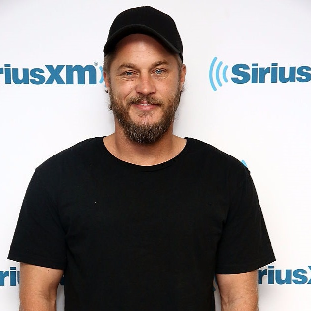 Actor Travis Fimmel looks handsome with trimmed beard and black dress while visiting SiriusXM Studios.