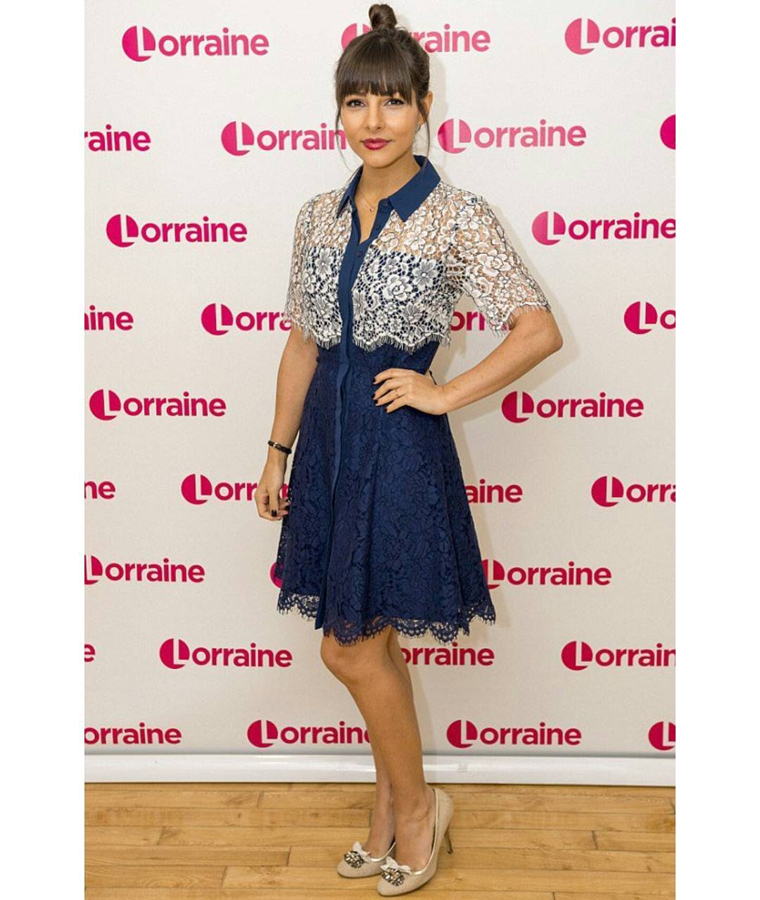 Roxanne Pallett is attending an event in blue and white dress