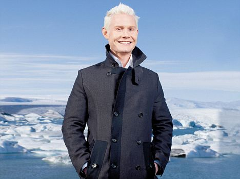 Rhydian Roberts wearing over-coat and putting his hand in its pockets