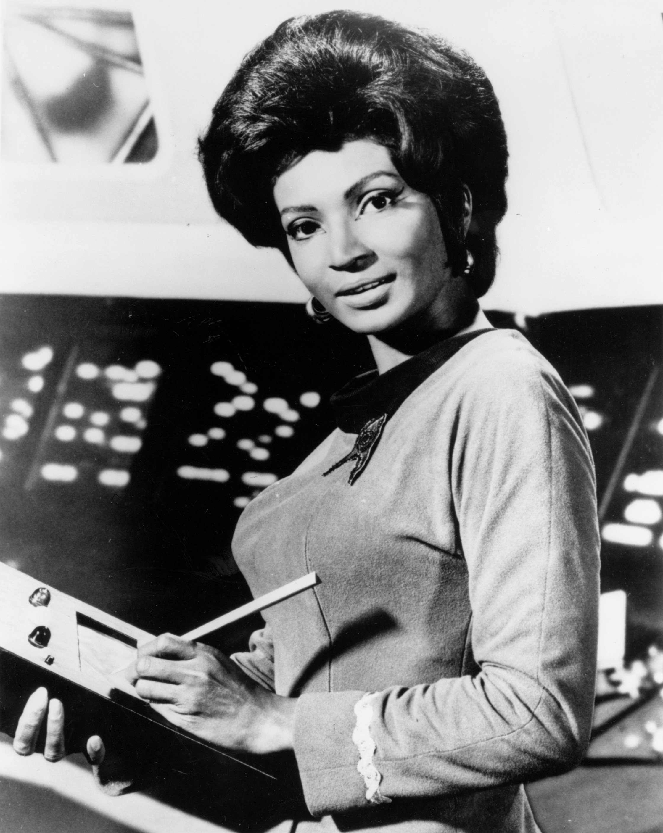 Black and White photo of Nichelle Nichols holding an astronomical device