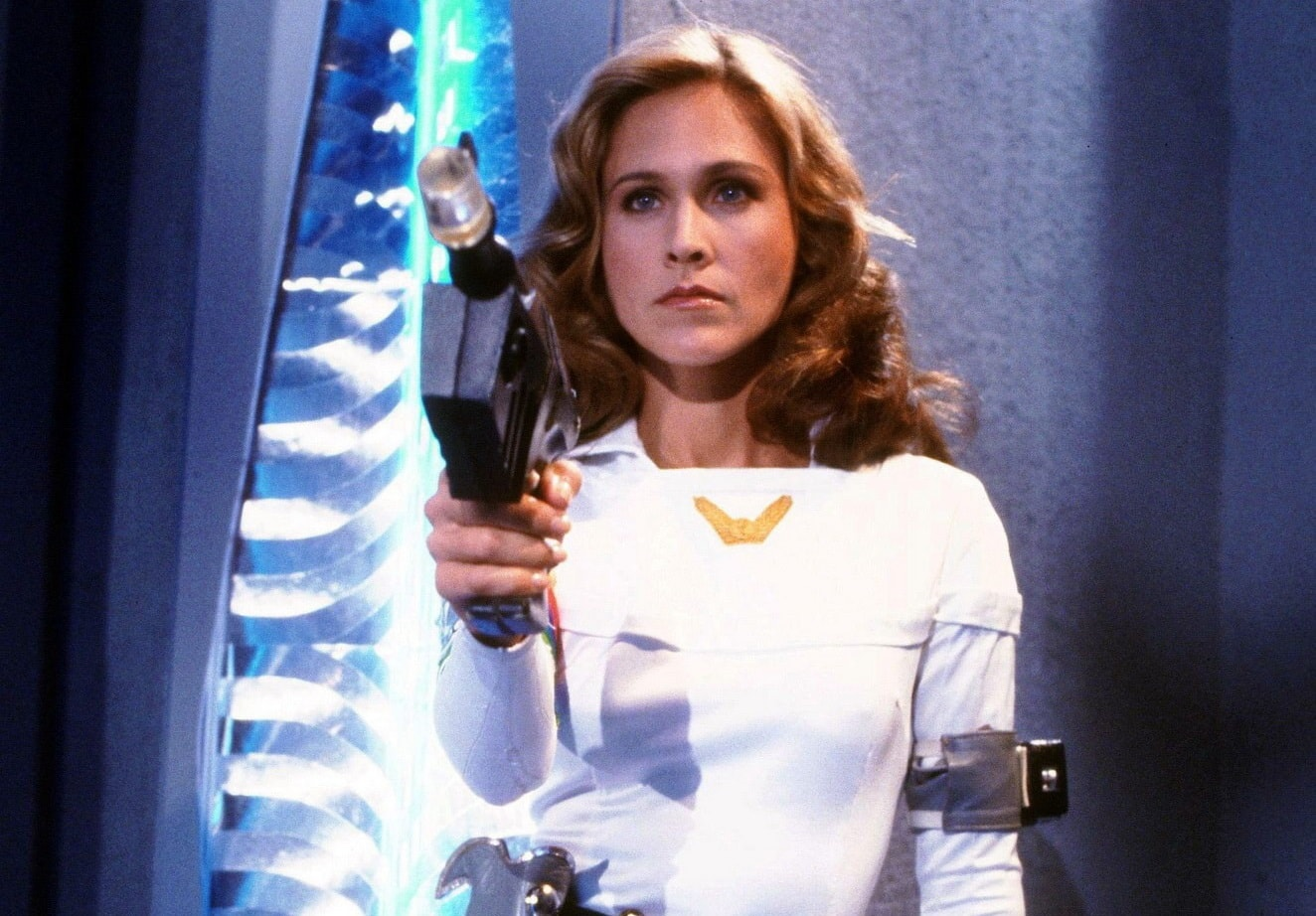 Erin Gray holding gun in while playing her colonel character in the movie