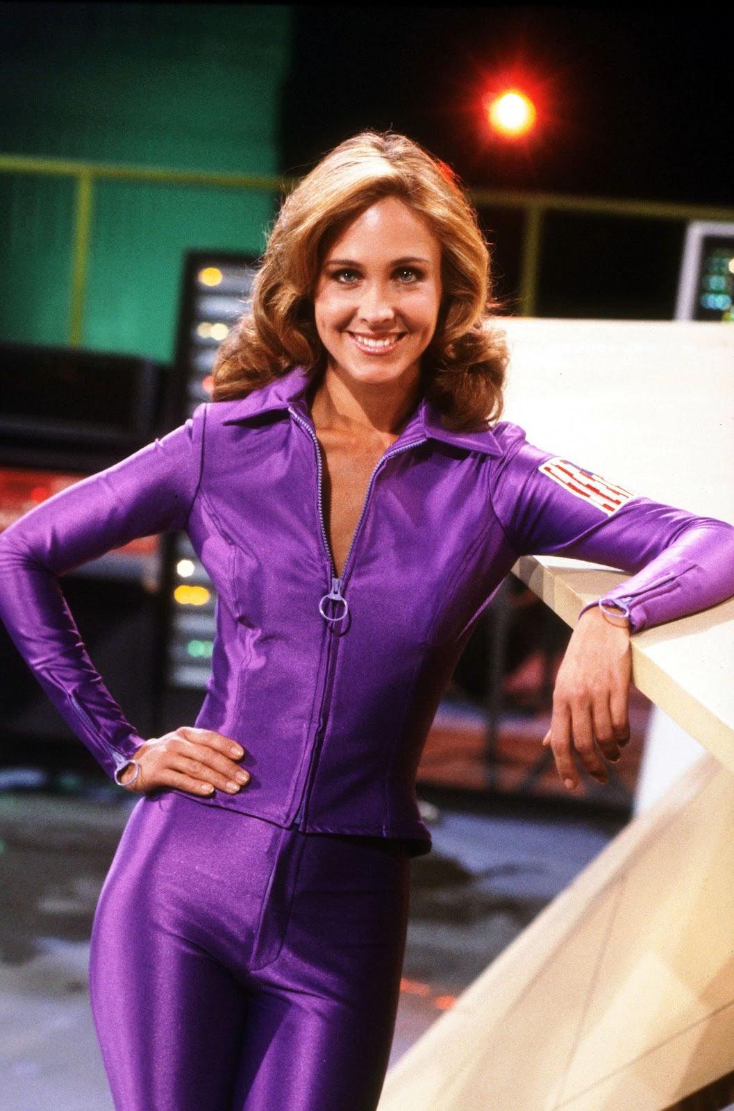 Erin Gray in a tight purple jumpsuit for her movie character