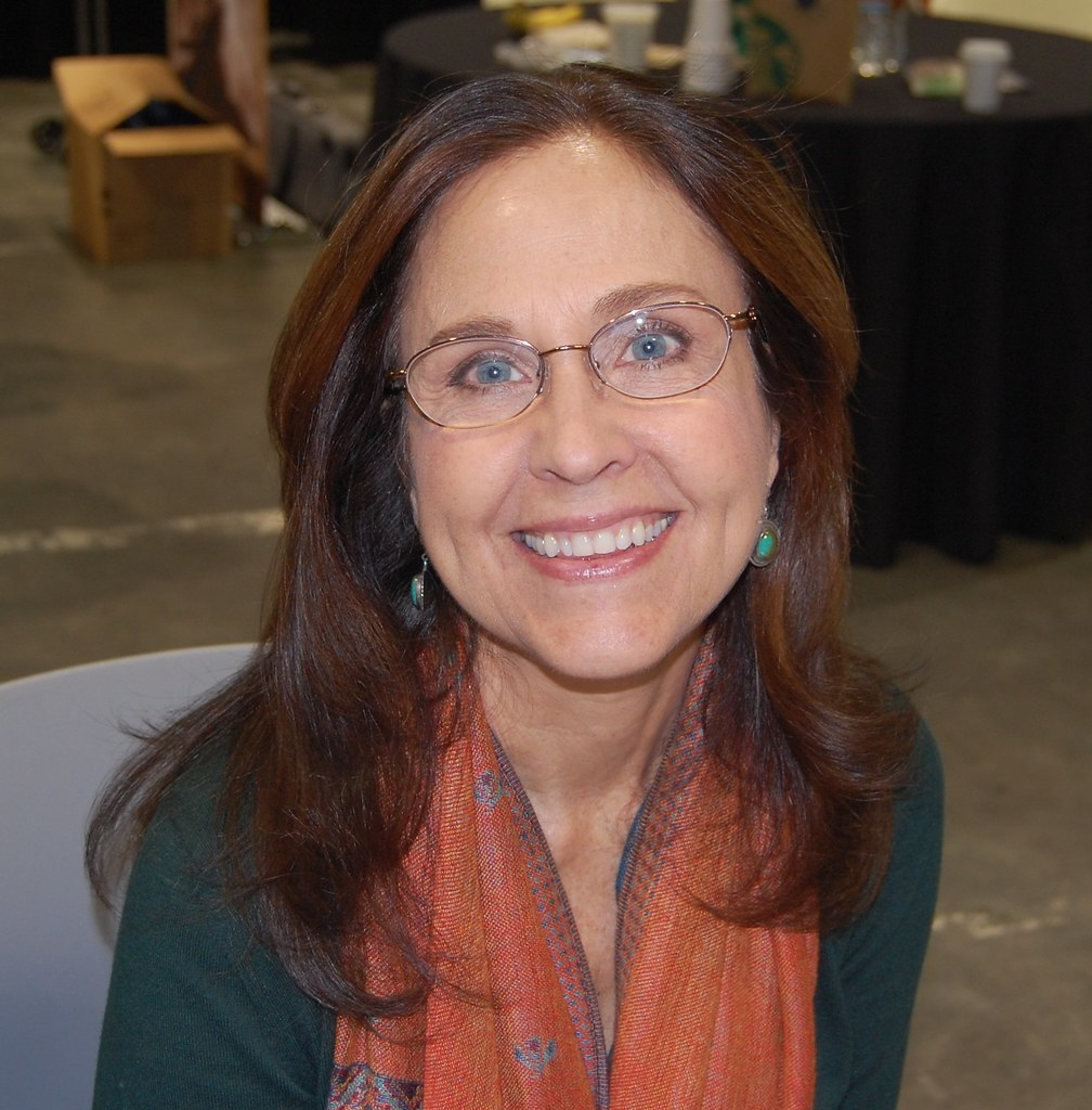 Smiling picture of Erin Gray wearing spectacles