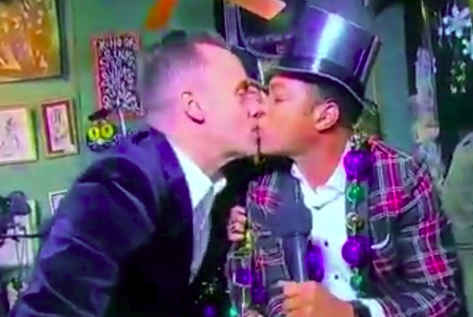 Don Lemon sharing a smooch with his boyfriend Tim Malone. The two kissed on air on New Year Eve.