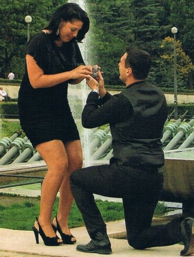 Ryan Debolt getting on one knee with a ring on his hand in front of his girlfriend, Sara Ramirez