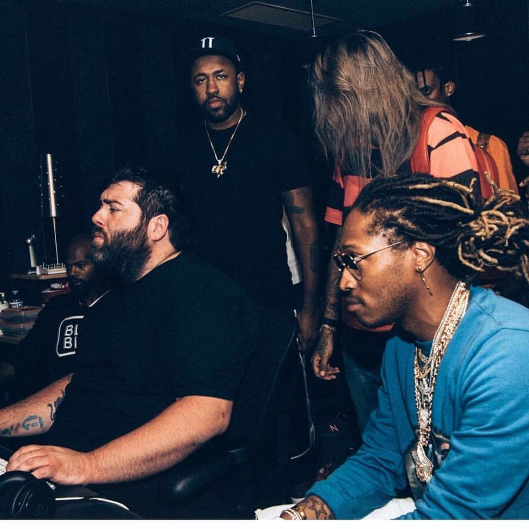 Seth Firkins in the studio sitting next to Future and Mike Will Made-it is standing behind him