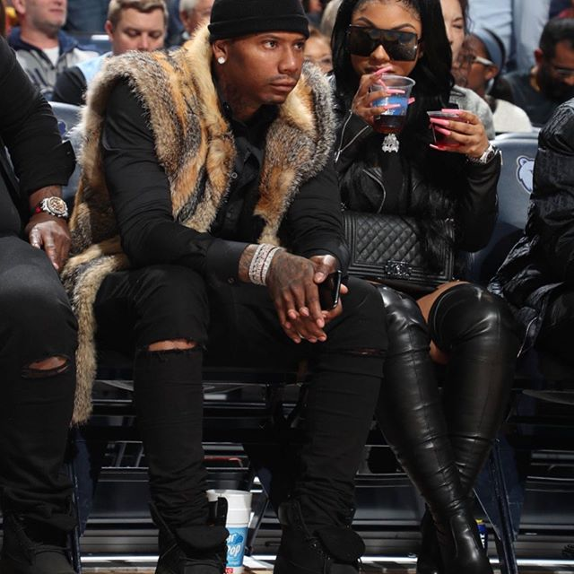 Ariana Fletcher and Rapper Moneybagg Yo at a basketball game. The couple started dating earlier this year