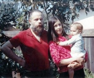 Isa Dick Hackett with her parents. Her mother, Nancy Hackett is holding her and father, Philip K. Dick is standing on the left side