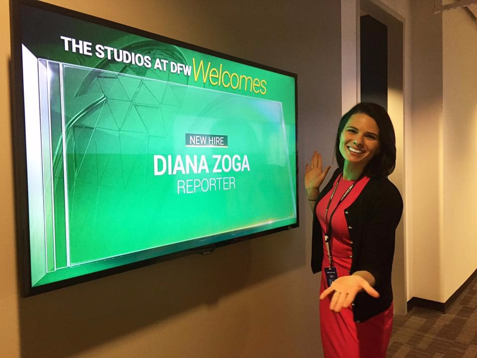Diana Zoga infront of a screen that says The Studios at KXAS welcomes Diana Zoga Reporter
