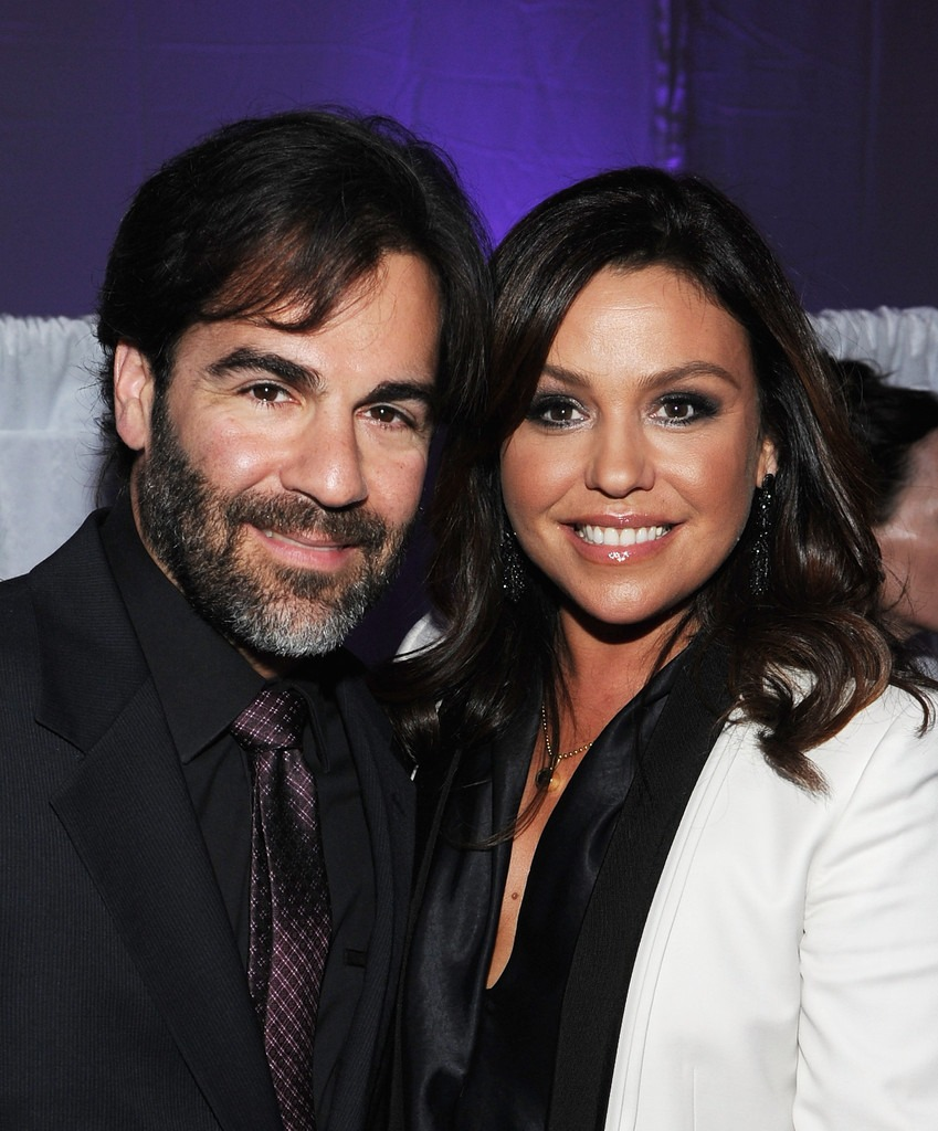 The Cringe band's frontman, John Cusimano and his wife, Rachael Ray smiling for the camera with a poise.