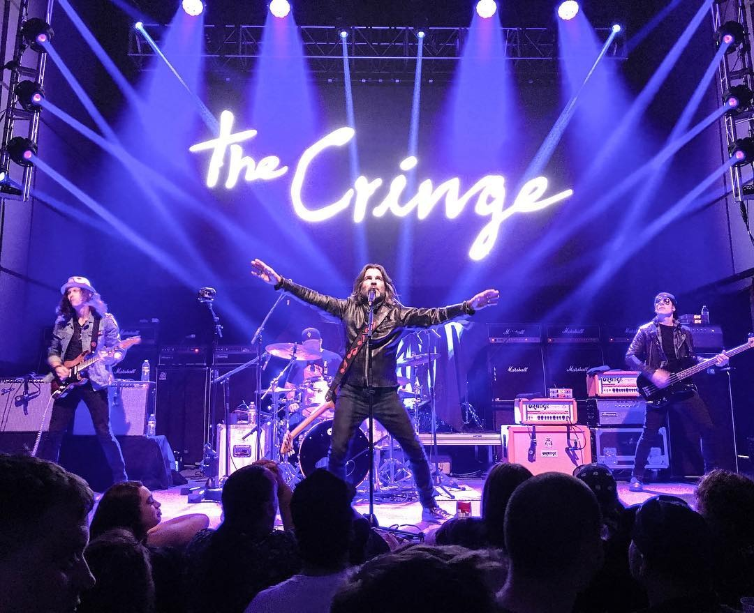 The rock band, The Cringe performing during their tour. John Cusimano is singing while other band members are with their instruments