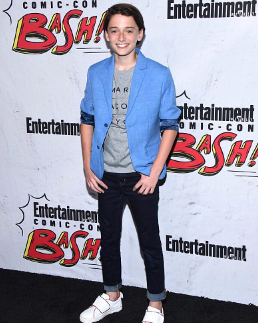Noah Schnapp looks adorable while he poses for the camera with his innocent smile. He is the main character in the second season of the Netflix's Stranger Things.