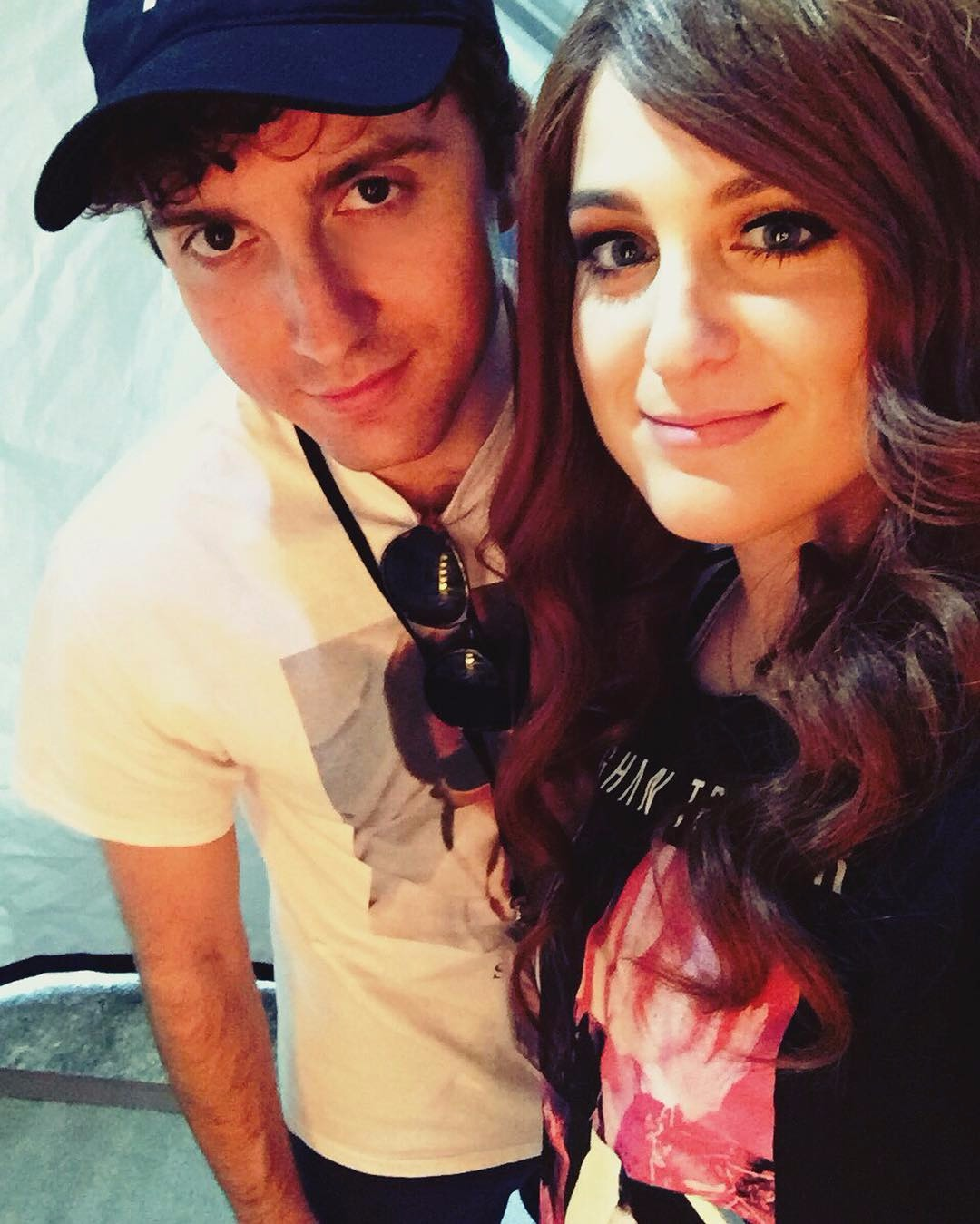 Meghan Trainor and her boyfriend Daryl Sabara giving modest smile to the camera.