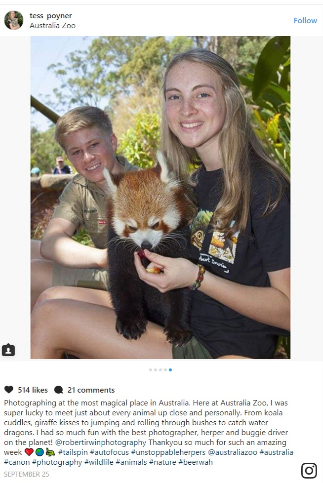 Tess Poyner holding a red panda, sitting beside Robert Irwin