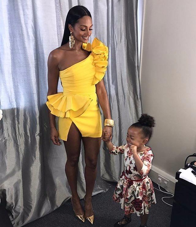 Alesha Dixon holding her daughter Azura's hand