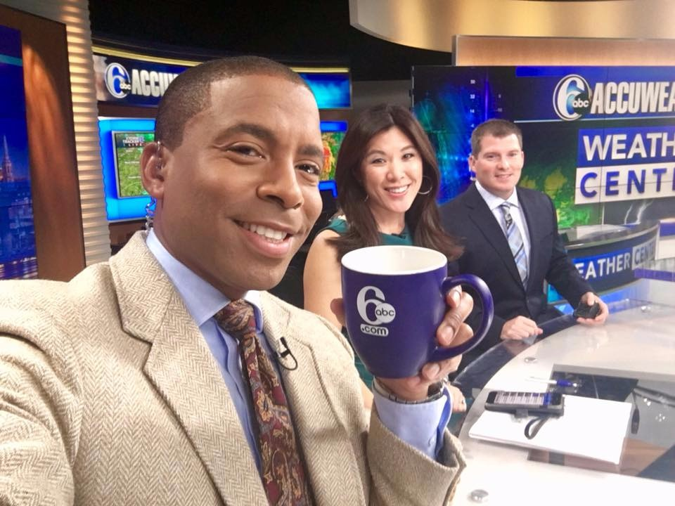 Gray Hall holding a cup in his hand,  Nydia Han and Chris Sowers are in the frame