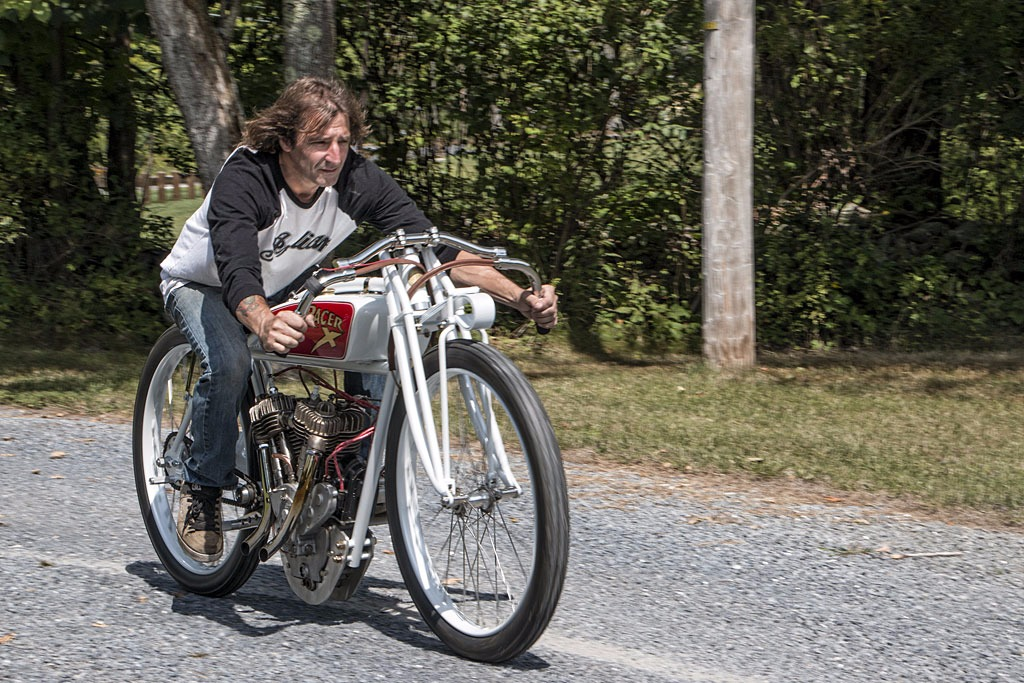 Rick Petko from Orange County Choppers on a motorcycle, he's wearing a baseball tee