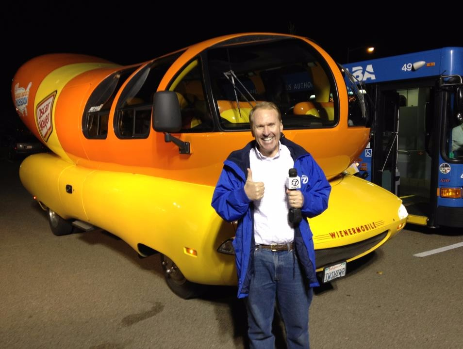 Mike Mangas standing in front of a Weinermobile