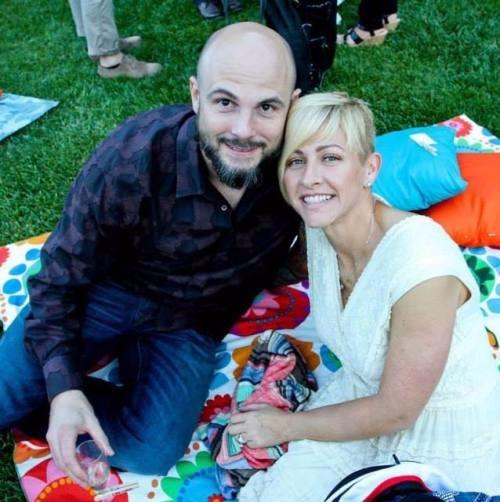 Christie Brimberry sitting on the grass with husband Daren Brimberry