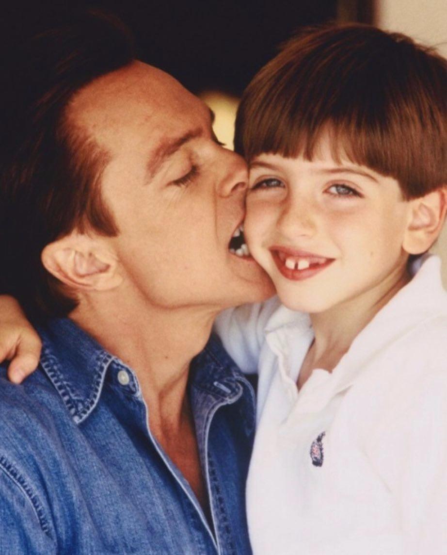David Cassidy closing his eyes and lovingly biting his son Beau Cassidy's cheek.