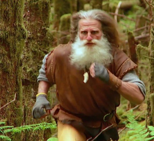 Mick Dodge running in the forest. Mick Dodge has been walking barefoot since 1991.