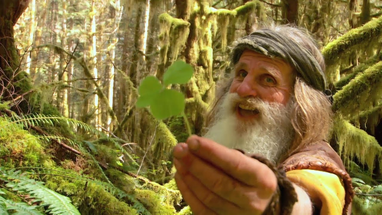 Mick Dodge holding a herb in his hand