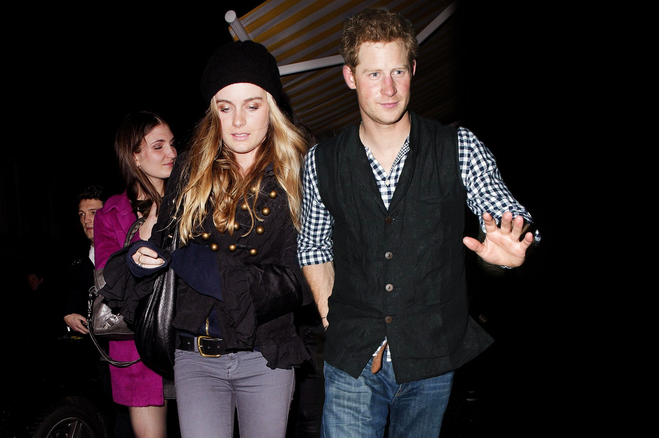 Cressida Bonas and Prince Harry are wearing black outfits. They dated for two years.