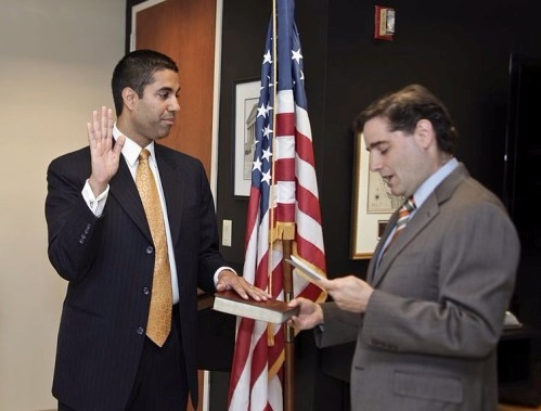 FCC Chariman Ajit Pai swearing in ceremony, Ajit Pai has one hand on a bible, another raised up