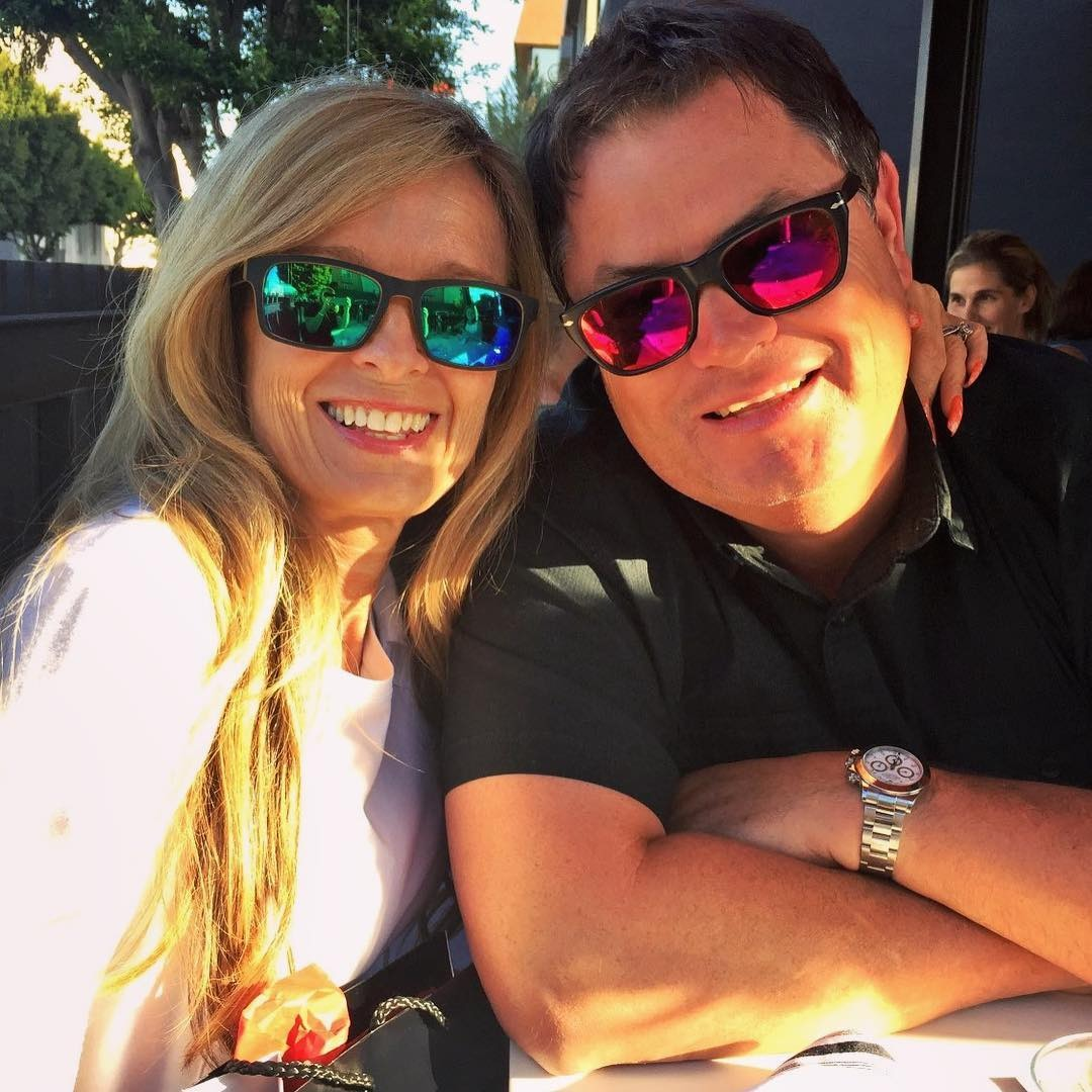 Mike Brewer is happy with his wife Michelle Brewer. Both of them are smiling at the camera.