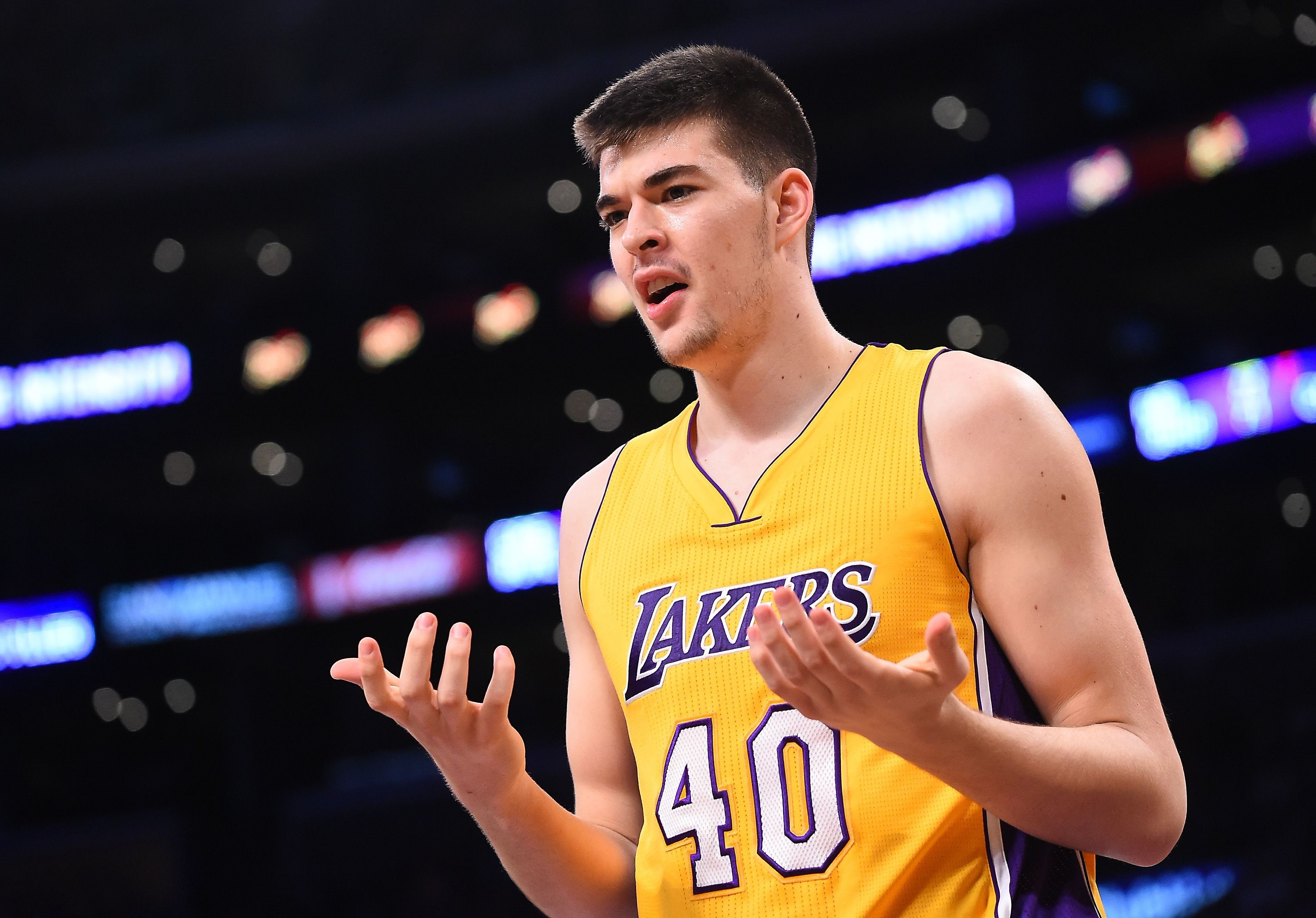 Ivica Zubac with his palms faced towards himself, he's wearing his Lakers jersey
