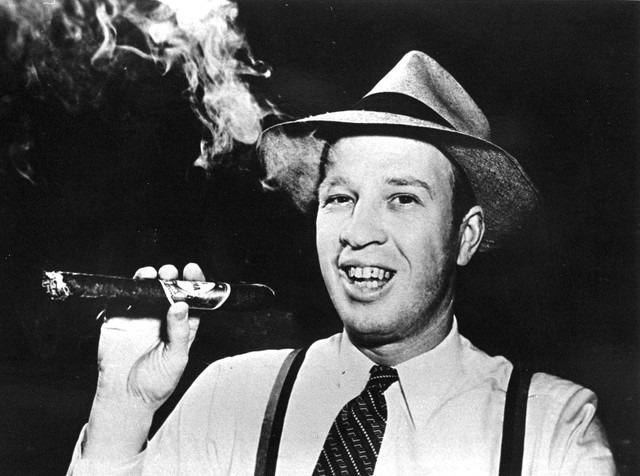 Frank Olson holding a big cigar