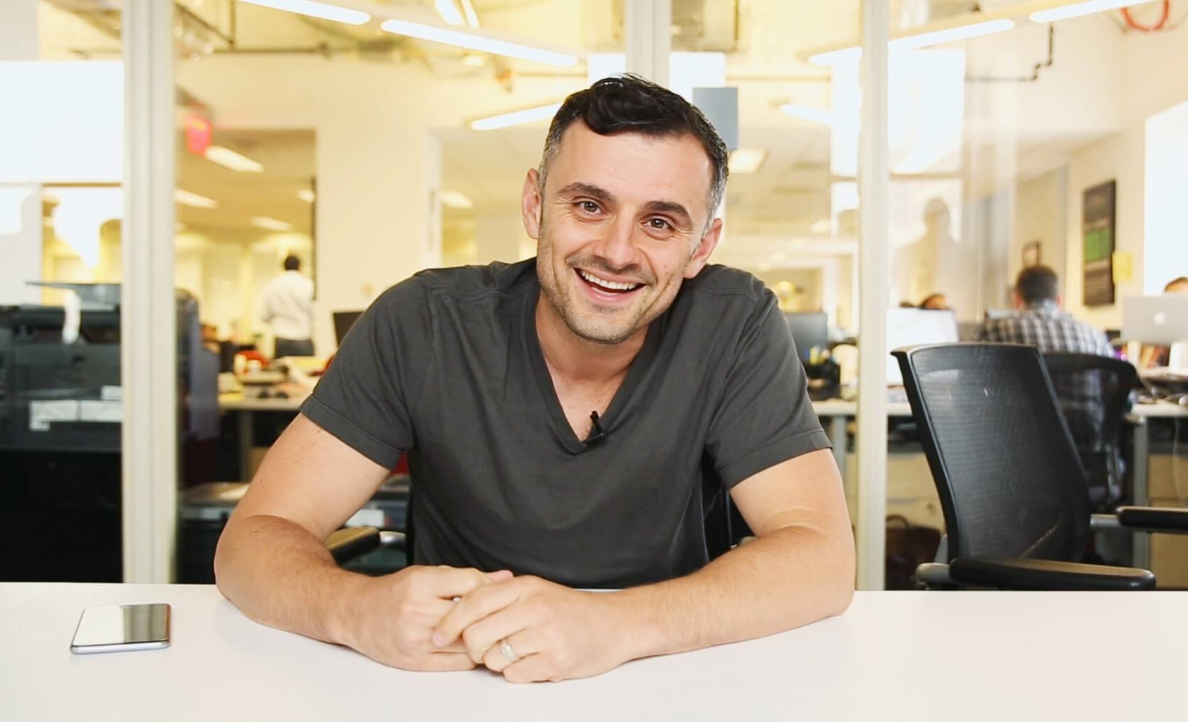 Gary Vaynerchuk at VaynerMedia, leaning his hands on the table