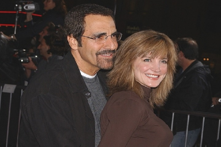 Crystal Bernard and her ex-boyfriend Tony Thomas are posing together at a public event. People with cameras are standing behind them.