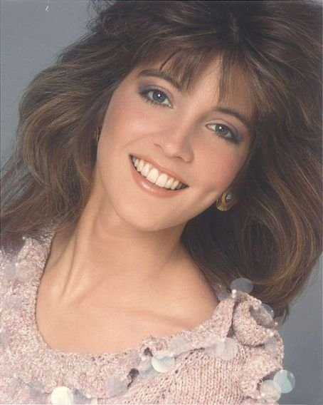 Crystal Bernard's photo from her young age. She is smiling, showing her teeth.