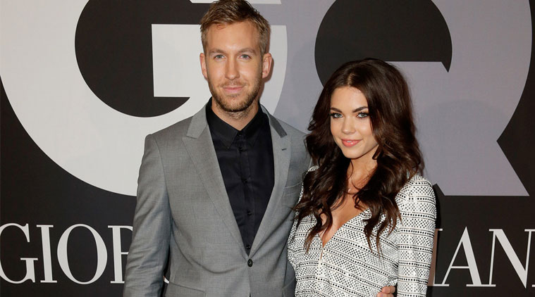 Calvin HArris and Aarika Wolf are standing next to eachother