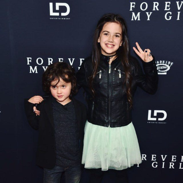 Abby Ryder Fortson poses with his brother, Joshua Taylor Fortson in Forever My Girl premiere.