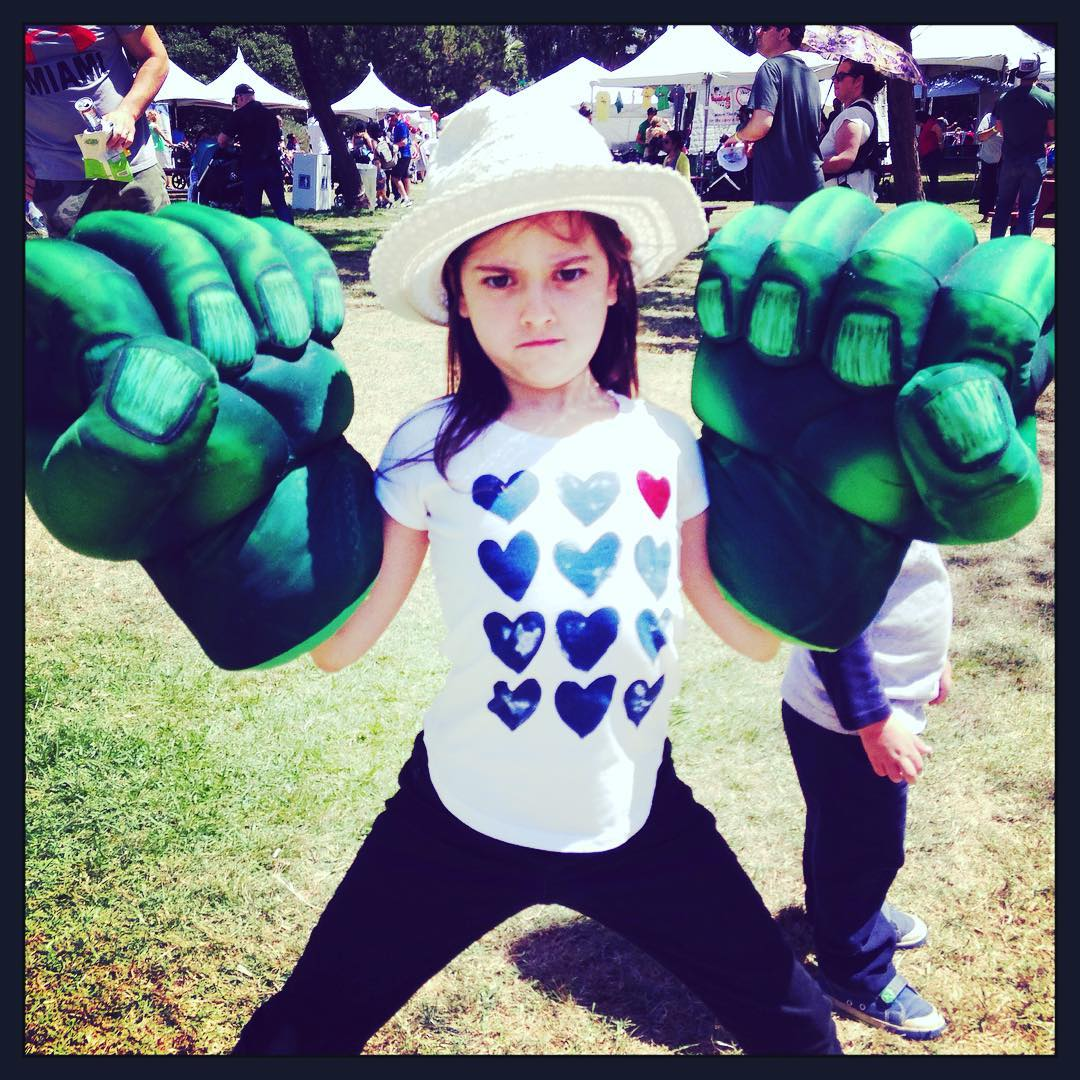 Abby Ryder Fortson poses with a huge Hulk hands.