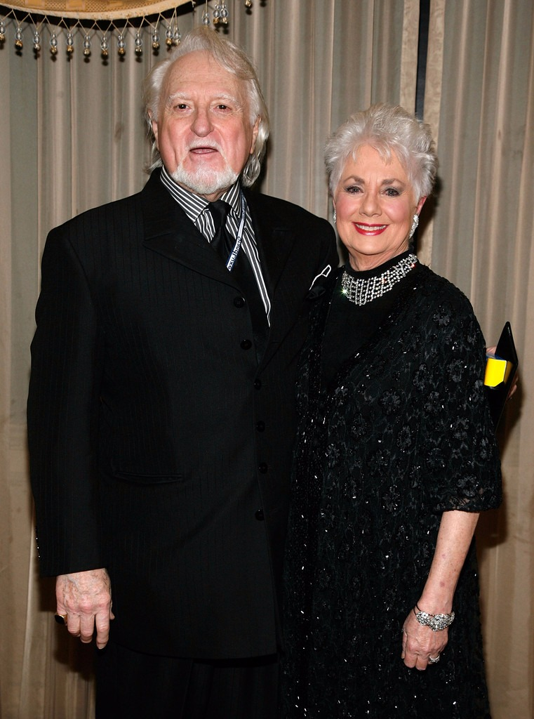 Grey-haired Shirley Jones and her husband Marty Ingels are dressed in black.