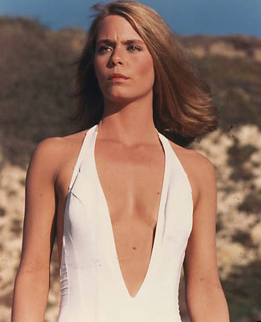 Susan Dey looks hot in the white swimwear. She is looking away from the camera and her shoulder-cut hair suits her a lot.