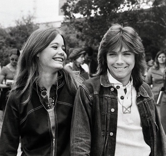 Susan Dey and David Cassidy at they young age. Susan is all in smiles while she is posing for the camera with her on-screen brother, David Casssidy.