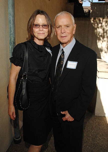 Susan Dey looks beautiful in the black dress. Her husband Bernard Sofronski is wearing a black suit. Bernard is Susan's second husband.