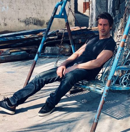 David Muir was sitting on a swing on a summer day