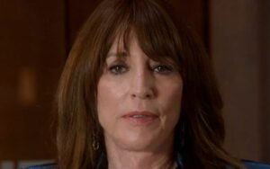 Katy Sagal with brown hair and earrings