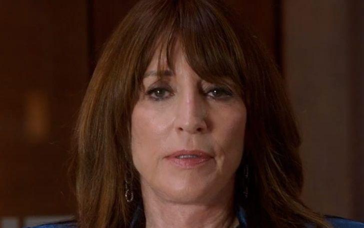 Katy Sagal with brown hair and earrings