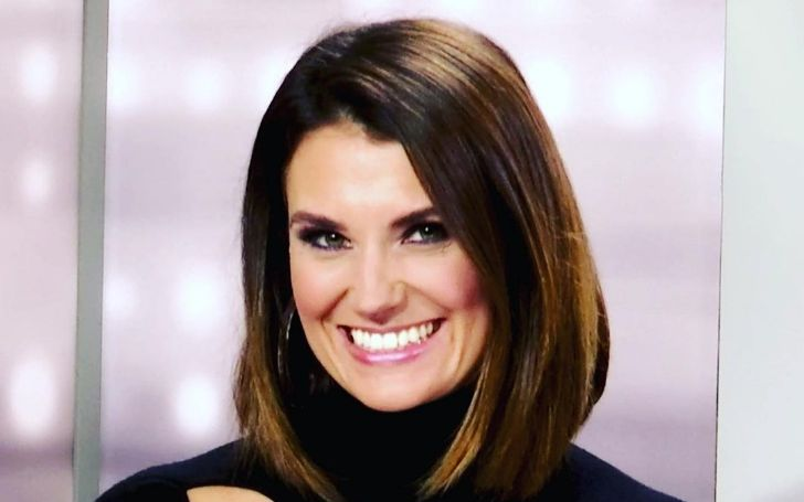 Krystal Ball smiling in Black dress and